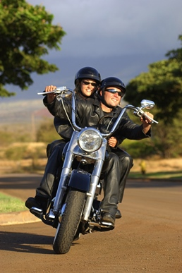 image of couple riding motorcycle