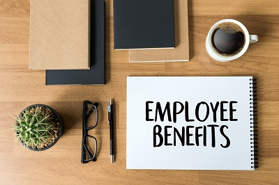 image of employee benefits folder on desk