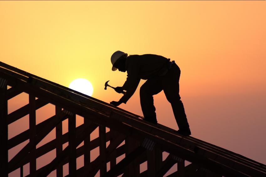 image of man building a house