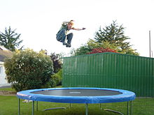 image of kid jumping on trampoline