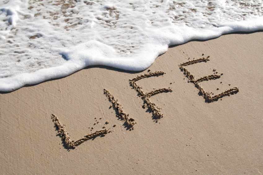 image of the word life written on beach sand